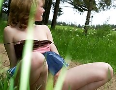 Beautiful teen peeing near the country road
