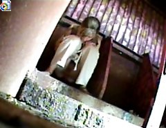 Horny voyeur plants his cam in public ladies' room