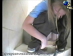 Two beautiful young blonde bitches get filmed by the spy cam while taking a quick leak in a public loo