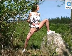 Teen peeing near the lake