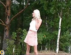 Cute blonde teen peeing outdoor