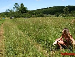 Beautiful teen peeing on the field