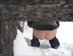 Hot chick flashes ass peeing on the snow