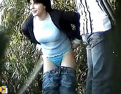 Busty beauty filmed peeing under trees