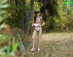Little babe takes a leak in the nearby bushes