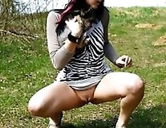 Glamorous chick with little doggy filmed pissing