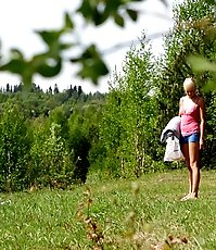 Hot girlie sunbathing naked in forest wants to pee