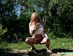 Teenage blondie empties her bladder in the woods